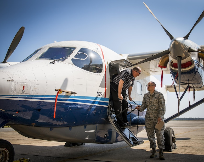 Dale Rice exits a C-145A Skytruck while talking with Maj. Terrell Eikner, the 919th Aircraft Maintenance Squadron commander, during the Crestview Military Affairs Committee's tour of Duke Field, Fla., March 23.  (U.S. Air Force photo/Tech. Sgt. Samuel King Jr.)
