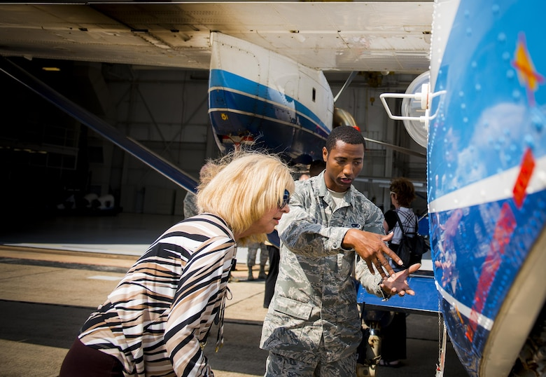 Senior Airman Mario Hill, 919th Aircraft Maintenance Squadron, explains how the C-145A Skytruck is refueled to Marian McBryde, a Crestview Military Affairs Committee member, during their tour of Duke Field, Fla., March 23.  (U.S. Air Force photo/Tech. Sgt. Samuel King Jr.)