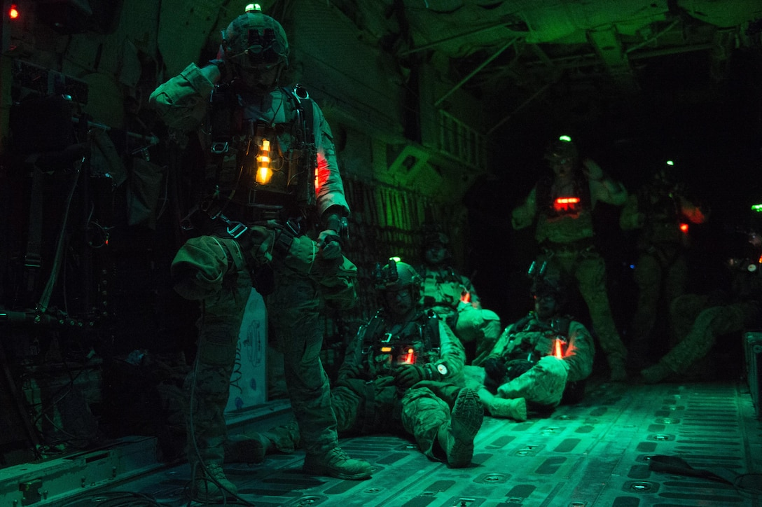 Pararescuemen from the 82nd Expeditionary Rescue Squadron prepare for a night jump from a C-130 Hercules over Grand Bara, Djibouti March 20, 2017. The training allowed the pararescuemen to maintain their qualifications on night jumps. The 82nd ERQS conducts full spectrum personnel recovery, casualty evacuation, medical evacuation, and sensitive item recovery in support of Defense Department  personnel. (U.S. Air Force photo/Tech. Sgt. Joshua J. Garcia)