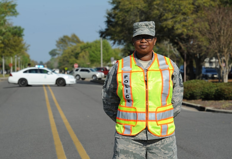"Senior Master Sgt. Lacreshia Trapp, 81st Communications Squadron superintendent, fulfills road guard duties during a Women's History Month all-female retreat ceremony March 21, 2017, on Keesler Air Force Base, Miss. The theme of 2017 WHM is ""Honoring Trailblazing Women in Labor and Business"" to honor women who have successfully challenged the female role in business and the paid labor force. (U.S. Air Force photo by Kemberly Groue)"