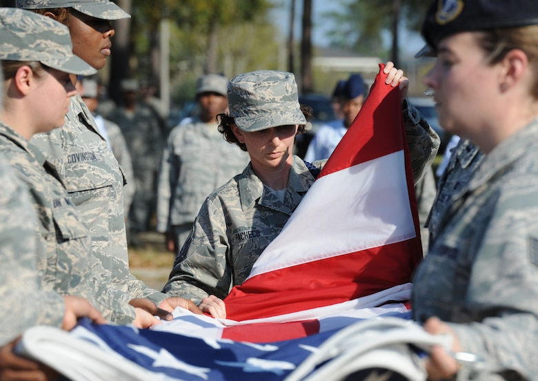 "Master Sgt. Amber Pacheco, 81st Training Group Air National Guard liaison, folds the U.S. flag during a Women's History Month all-female retreat ceremony March 21, 2017, on Keesler Air Force Base, Miss. The theme of 2017 WHM is ""Honoring Trailblazing Women in Labor and Business"" to honor women who have successfully challenged the female role in business and the paid labor force. (U.S. Air Force photo by Kemberly Groue)"