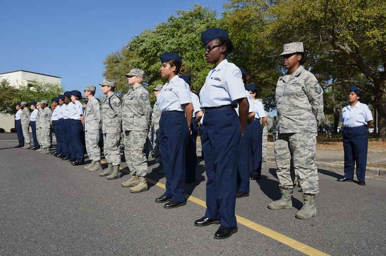 "Airmen and Biloxi High School Junior ROTC cadets participate in a Women's History Month all-female retreat ceremony March 21, 2017, on Keesler Air Force Base, Miss. The theme of 2017 WHM is ""Honoring Trailblazing Women in Labor and Business"" to honor women who have successfully challenged the female role in business and the paid labor force. (U.S. Air Force photo by Kemberly Groue)"