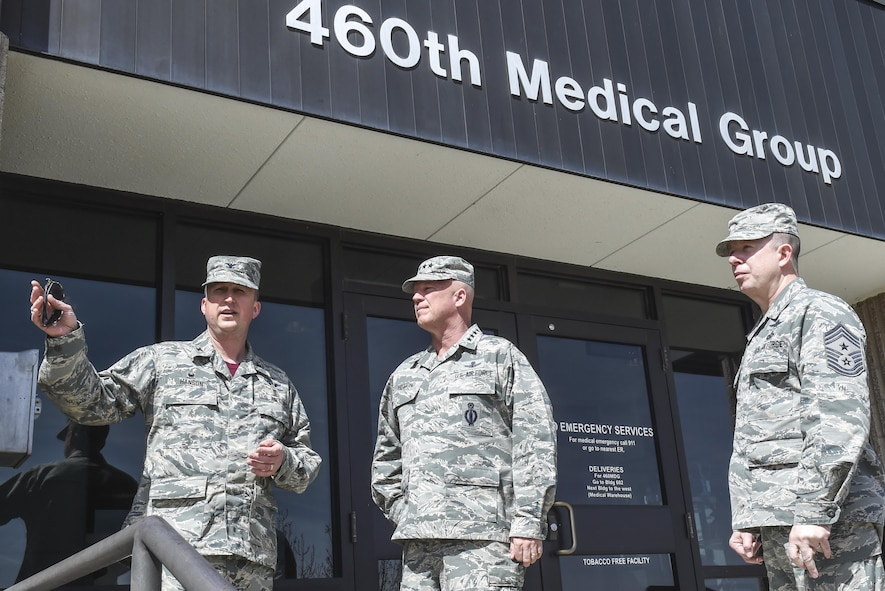 Col. Matthew Hanson, 460th Medical Group commander, left, talks about the changes coming to the 460th MDG with Gen. Jay Raymond, commander of Air Force Space Command, center, and Chief Master Sgt. Brendan Criswell, AFSPC command chief, March 17, 2017, at Buckley Air Force Base, Colo. Buckley boasts America's Premier Space Wing, installation support to 95 multiservice and multinational units, a population of over 94,000 Team Buckley members, and a mission that is critical to the nation's safety. (U.S. Air Force photo by Tech. Sgt. Nicholas Rau)