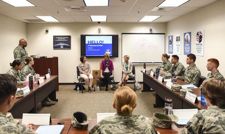 Mrs. Mollie Raymond, the general's wife and quality of life champion, center, speaks with Airmen in the First Term Airmen Course, March 17, 2017, about their expectations while stationed here at Buckley Air Force Base, Colo. Buckley boasts America's Premier Space Wing, installation support to 95 multiservice and multinational units, a population of over 94,000 Team Buckley members, and a mission that is critical to the nation's safety. (U.S. Air Force photo by Airman Holden Faul)