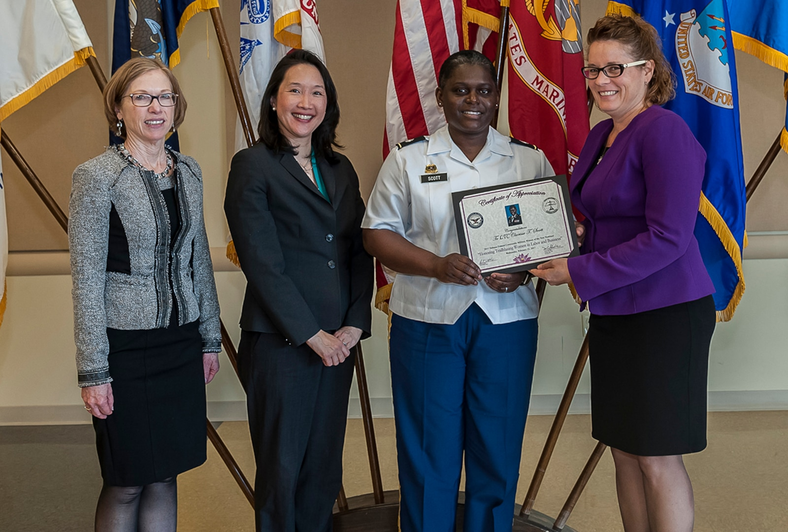 The 2017 Military Woman of the Year was Army Lt. Col. Clarisse Scott, military deputy director of Land Supplier Operations at DLA Land and Maritime. She received the award during an annual Women's History Month Luncheon Mar. 22 at Defense Supply Center Columbus. Pictured with Scott is (from left) Deborah Haven, Land and Maritime deputy director of Maritime Customer Operations; Jenny Yang, U.S. EEO commissioner; and Rebecca Beck, deputy site director for DFAS Columbus.