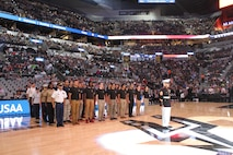 RS San Antonio Marine poolees participated in the San Antonio Spurs vs Memphis Grizzlies' half-time show on March 23rd. The annual USAA and Spurs Military Appreciation Night honors military members, their families and Armed Forces enlistees. The future Marines raised their right hands in front of the packed AT&T Center audience to swear-in by repeating the Oath of Enlistment. (U.S. Marine Corps Photo by Sgt. Guadalupe Campos)
