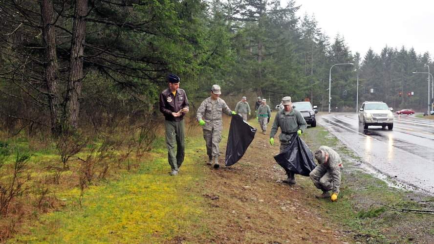 Members of Team McChord collect garbage along Perimeter Road outside the Barnes Gate at Joint Base Lewis-McChord, Wash., March 17, 2017. Approximately 40 volunteers, coordinated by Staff Sgt. Joshua Barnes, 7th Airlift Squadron C-17A loadmaster, collected 465 pounds of trash from a two-mile stretch on Perimeter Road. (U.S. Air Force photo/Staff Sgt. Whitney Amstutz)