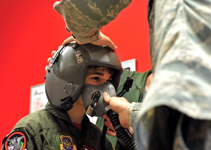 """Stillen Rivera, Team McChord's newest """"Pilot for a Day"""" participant, gets the pilot treatment during a visit to the 62nd Operations Support Squadron Aircrew Flight Equipment section, March 23, 2017 at Joint Base Lewis-McChord, Wash. The """"Pilot for a Day"""" program has been hosted by Team McChord for the past several years, and seeks to fulfil the dreams of youth with limiting disabilities. (U.S. Air Force photo/Staff Sgt. Whitney Amstutz)"""