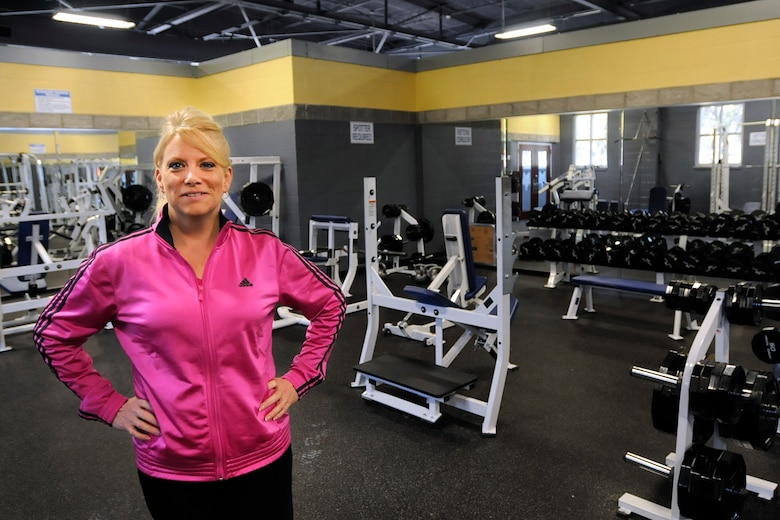 """Michelle Walker, the Recreational Specialist at McEntire Joint National Guard Base, S.C., poses for her photo in the base gym on November 2, 2011.  Michelle was hired to work at the base gym to train, educate and encourage McEntire's airmen to remain """"fit to fight"""" and excel in the new Air Force fitness standards.  (SCANG photo by TSgt Caycee Cook)"""