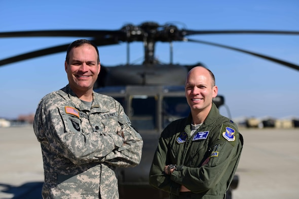 U.S. Army Lt. Col. Christopher Moenster, left, and U.S. Air Force Lt. Col. Todd Moenster, brothers, are both pilots currently serving at Whiteman Air Force Base, Mo.