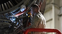 Staff Sgt. Lewis Cole, 514th Maintenance Squadron propulsion flight air reserve technician, performs maintenance on a C-17 Globemaster III jet engine at Joint Base McGuire-Dix-Lakehurst, New Jersey, March 23, 2017. The 305th Maintenance Squadron is total force and utilizes the knowledge and skill of a team of active duty and reserve airmen as well as civilian members.