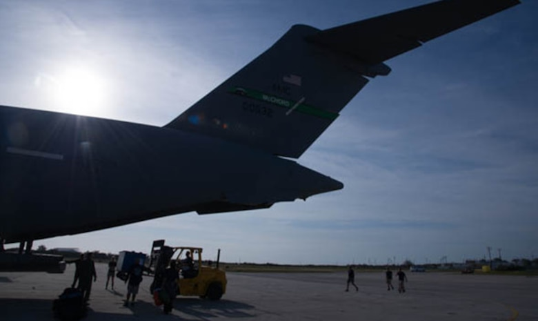 Dolphins from the U.S. Navy's Marine Mammal Program are unloaded from a C-17 Globemaster III, operated by the 446th Airlift Wing, March 13, 2017. The dolphins, with trainers and veterinarians, were being transported from San Diego to Key West, Florida. (U.S. Air Force photo by David L. Yost)