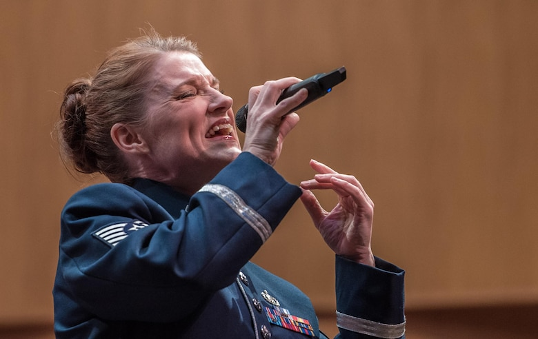 Tech. Sgt. Paige Wroble, U.S. Air Force Band Airmen of Note vocalist, sings during a Jazz Heritage Series performance in Alexandria, Va., March 23, 2017. The series began in 1990 and is broadcast to millions each year through National Public Radio, independent jazz radio stations, satellite radio services and the internet. (U.S. Air Force photo by Senior Airman Jordyn Fetter)