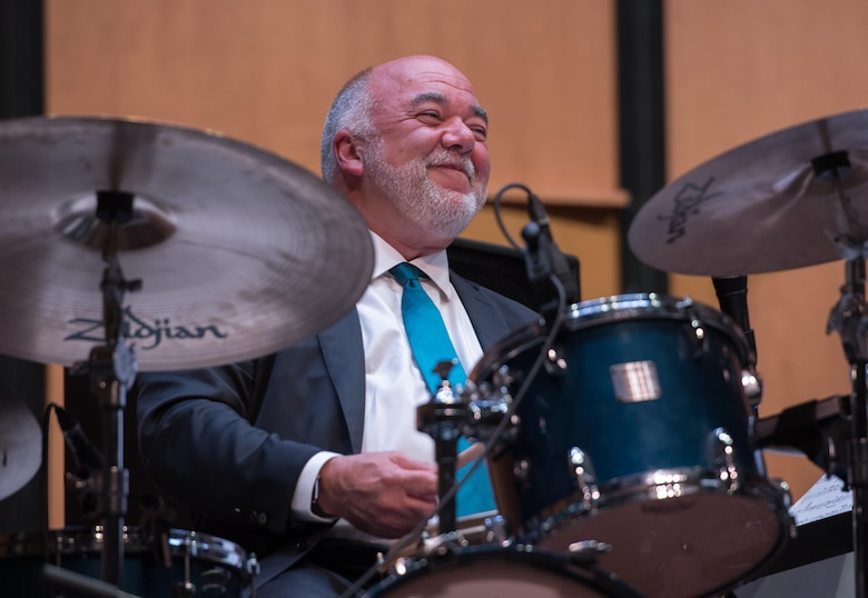 "Peter Erskine, American jazz drummer, smiles after performing alongside the U.S. Air Force Band Airmen of Note at a Jazz Heritage Series concert in Alexandria, Va., March 23, 2017. Erskine is a renowned musician, having won two Grammy Awards and ""Best Jazz Drummer of the Year"" by Modern Drummer Magazine readers 10 times. He is one of many jazz icons who have participated in the series, which began in 1990. (U.S. Air Force photo by Senior Airman Jordyn Fetter)"
