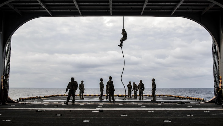 Marines fast-rope from an MV-22B Osprey onto the port aircraft elevator of the amphibious assault ship USS Bonhomme Richard in the Philippine Sea, March 21, 2017. Navy photo by Seaman Apprentice Jesse Marquez Magallanes