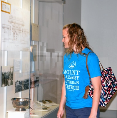 Lauren Hannemann views an exhibit at the Fort Sam Houston Museum. Located in the historic Quadrangle, the museum contains six rooms of exhibits, displays and artifacts on the history of Fort Sam Houston and a reference library and archives.