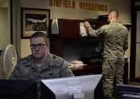 U.S. Air Force Airman Ian Steele, 19th Operations Support Squadron Airfield Management shift lead, mans the customer service desk March 20, 2017, at the airfield management shop on Little Rock Air Force Base, Ark. Members of the 19th Operations Support Squadron Airfield Management team work around the clock to provide a safe, efficient and effective airfield environment for all aircraft operations. (U.S. Air Force photo by Airman 1st Class Grace Nichols)