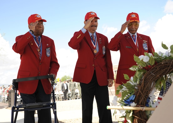 Three of the original Tuskegee Airmen from the Archer-Ragsdale Chapter salute a wreath placed at the Tuskegee Airmen Memorial Air Park March 23, 2017, at Luke Air Force Base, Ariz. For the fourth year in a row, Luke commemorated the Tuskegee Airmen and their contributions to the Air Force and the United States. (U.S. Air Force photo by Airman 1st Class Caleb Worpel)