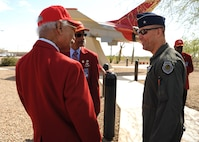 Brig. Gen. Brook Leonard, 56th Fighter Wing Commander, interacts with members of the Archer-Ragsdale Chapter of Tuskegee Airmen March 23, 2017, at Luke Air Force Base, Ariz. Luke's relationship with the Tuskegee Airmen stems through the 302nd Fighter Squadron which was one of four African-American fighter squadrons to enter combat during World War II. The 302nd FS was attached to the 944th Fighter Wing Reserve Component which calls Luke home today. (U.S. Air Force photo by Airman 1st Class Caleb Worpel)