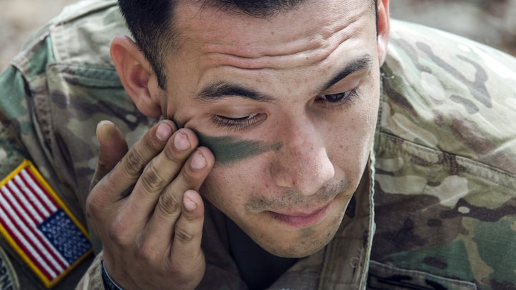 Army Staff Sgt. Armando Alvarado applies face paint during training for an Expert Infantryman Badge competition at Fort Jackson, S.C., March 17, 2017. Alvarado is assigned to the 2nd Battalion, 13th Infantry Regiment. Army photo by Robert Timmons