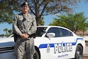 Airman 1st Class Molly Marshall, an installation patrolman assigned to the 6th Security Forces Squadron, pauses for a photo in front of her patrol car March 24, 2017 at MacDill Air Force Base, Fla. Marshall is responsible for performing routine patrols of the intersections around MacDill, to ensure all traffic laws are followed. (U.S. Air Force photo by Airman 1st Class Adam R. Shanks)