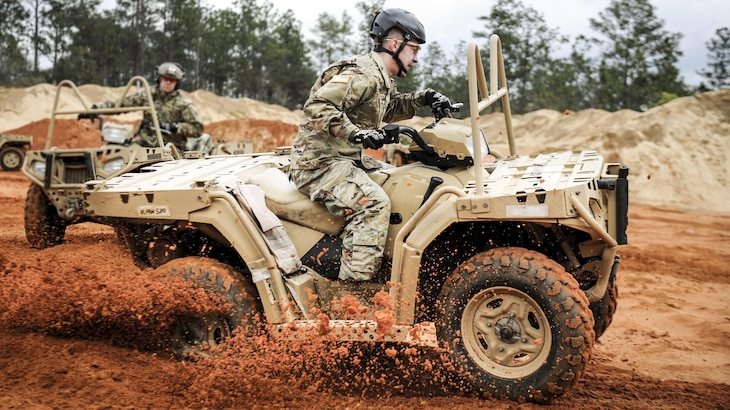 A soldier assigned to the 10th Special Forces Group steers an all-terrain vehicle during training in Navarre, Fla., March 14, 2017, to qualify to use ATVs in special operations missions. Air Force photo by Airman 1st Class Dennis Spain