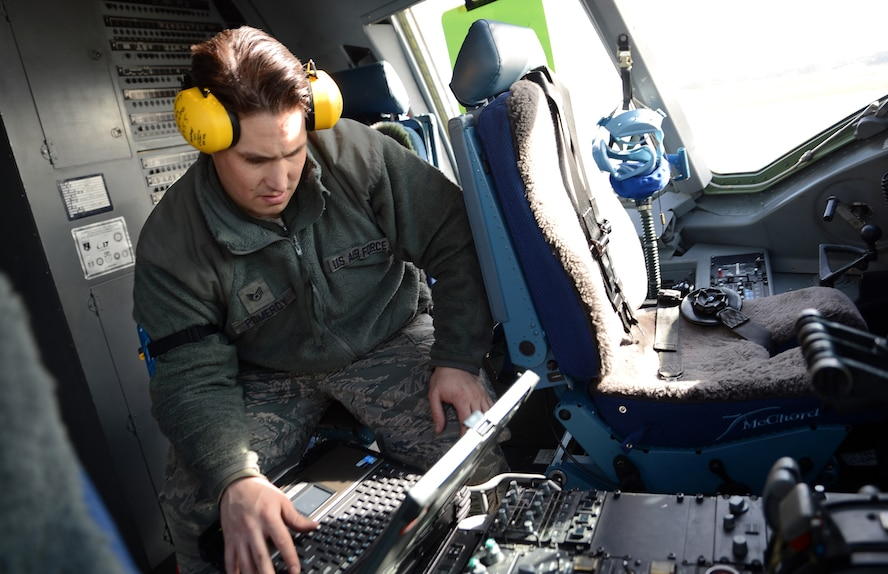 Staff Sgt. James Pomeroy, 62nd Aircraft Maintenance Squadron crew chief, reviews technical orders for turning power on in a C-17 Globemaster III aircraft March 20, 2017 at Joint Base Lewis-McChord, Wash. Crew chiefs are the first in the line responsibility to maintain aircraft and are responsible for ensuring aircraft are airworthy and ready to fly in moment's notice. (U.S. Air Force photo/Senior Airman Jacob Jimenez)