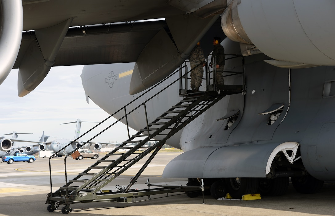 Senior Airman Facundo Santamina (left), 62nd Aircraft Maintenance Squadron crew chief and Staff Sgt. James Pomeroy, 62nd AMXS crew chief, inspect the wing of a C-17 Globemaster III aircraft March 20, 2017 at Joint Base Lewis-McChord, Wash. Crew chiefs have a large number of different duties they are trained in and perform regularly to ensure the safety of aircraft. (U.S. Air Force photo/Senior Airman Jacob Jimenez)