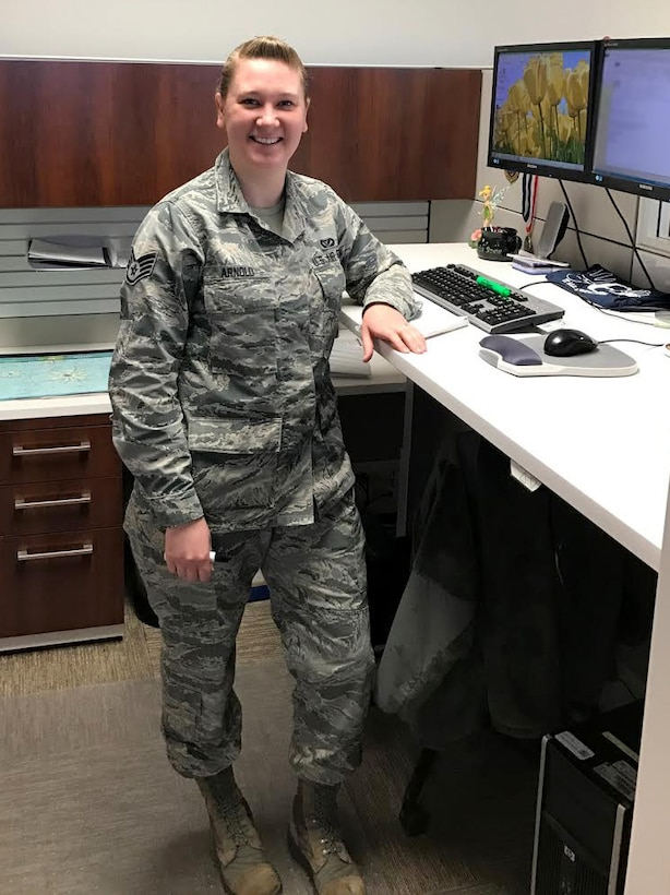 Staff Sgt. Ashley Arnold, 460th Civil Engineer Squadron Requirements and Optimizations NCO in-charge, poses for a photo at her desk on Buckley Air Force Base, Colo. Arnold is the 2016 Maj. Gen. Eugene A. Lupia Award winner. This award signifies superior job performance as an NCO in the CE career field. (Courtesy photo)