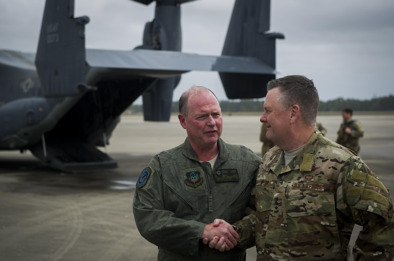 Maj. Gen. Eugene Haase, left, vice commander of Air Force Special Operations Command, is greeted by Lt. Gen. Brad Webb, commander of AFSOC, after Haase's final flight before his retirement at Hurlburt Field, Fla., March 24, 2017. Haase has logged more than 3,500 flight hours in his career and served as the AFSOC vice commander for the past 30 months before his retirement ceremony, April 10. (U.S. Air Force photo by Airman 1st Class Joseph Pick)