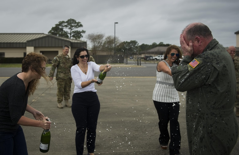 Maj. Gen. Eugene Haase, left, vice commander of Air Force Special Operations Command, is greeted by family and friends, after Haase's final flight before his retirement at Hurlburt Field, Fla., March 24, 2017. Haase has logged more than 3,500 flight hours in his career and served as the AFSOC vice commander for the past 30 months before his retirement ceremony, April 10.