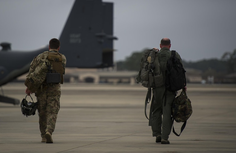 Maj. Nathan Eaton, left, a pilot with the 8th Special Operations Squadron, walks with Maj. Gen. Eugene Haase, vice commander of Air Force Special Operations Command, to an 8th SOS CV-22 Osprey tiltrotor aircraft before Haase's final flight at Hurlburt Field, Fla., March 24, 2017. Haase has logged more than 3,500 flight hours in his career and served as AFSOC's vice commander for the past 30 months before his retirement, April 10. (U.S. Air Force photo by Airman 1st Class Joseph Pick)
