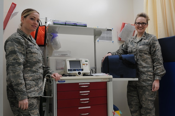 Capt. Heather Crawford, 81st Medical Support Squadron Medical Logistics Flight medical material director, and Maj. Sarah Abel, 81st Medical Operations Squadron internal medicine flight commander, stand next to one of the new 81st Medical Group crash carts March 22, 2017, on Keesler Air Force Base, Miss. Members of the 81st MDG recently and 81st Training Group teamed up to  organize and build 26 carts in an effort to standardize procedures within the hospital and align with where the Air Force Medical Operations Agency is taking the service's healthcare enterprise. (U.S. Air Force photo by Senior Airman Holly Mansfield)