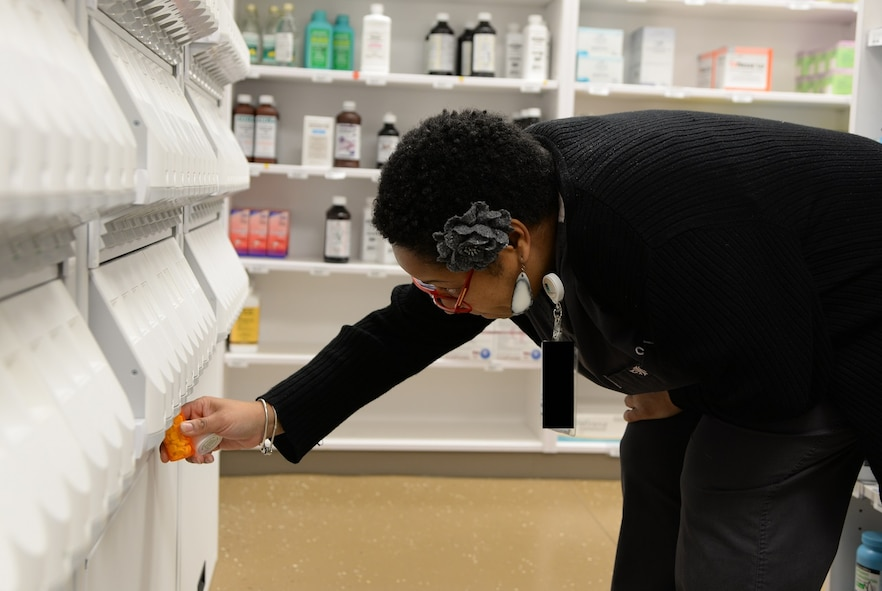 Juliette Zuber, 14th Medical Support Squadron Pharmacy, uses the new prescription dispensing machine to fill a patient's prescription March 13, 2017, at Columbus Air Force Base, Mississippi. The new machine eliminates pharmacy technicians having to count pills for patients' prescriptions. (U.S. Air Force photo illustration by Airman 1st Class Beaux Hebert)