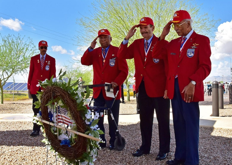 (Ret.) Lt. Col. Asa Herring, (Ret.) Tech. Sgt. Rudolf Silas, and (Ret.) Lt. Col. Robert Ashby, three of the original Tuskegee Airmen, render a salute Mar. 23 during the fourth annual Commemoration Day for the Tuskegee Airmen in Arizona at Luke Air Force Base, Ariz. (U.S. Air Force photo by Tech. Sgt. Louis Vega Jr.)