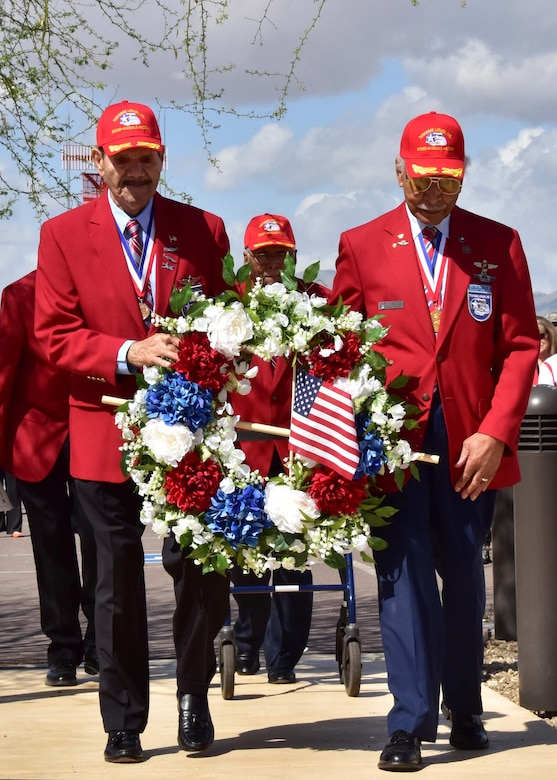 (Ret.) Tech. Sgt. Rudolf Silas, and (Ret.) Lt. Col. Robert Ashby, two of the original Tuskegee Airman, carry a wreath Mar. 23 during the fourth annual Commemoration Day for the Tuskegee Airmen in Arizona at Luke Air Force Base, Ariz. (U.S. Air Force photo by Tech. Sgt. Louis Vega Jr.)