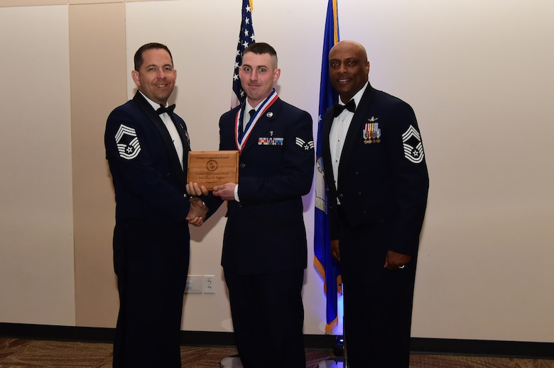 Senior Airman Dane Carder accepts the academic award during an Airman Leadership School graduation March 23, 2017, at the Leadership Development Center on Buckley Air Force Base, Colo. This award represents Airmen who received the highest grade in their class. (U.S. Air Force photo by Airman 1st Class Jessica Huggins/Released)
