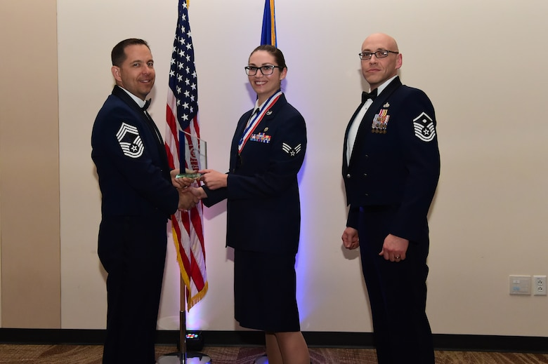 Senior Airman Jayme Little accepts the leadership award during an Airman Leadership School graduation March 23, 2017, at the Leadership Development Center on Buckley Air Force Base, Colo. This award represents Airmen who exhibited exemplary leadership skills within their class. (U.S. Air Force photo by Airman 1st Class Jessica Huggins/Released)