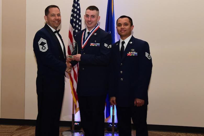 Senior Airman Dane Carder accepts the distinguished graduate award during an Airman Leadership School graduation March 23, 2017, at the Leadership Development Center on Buckley Air Force Base, Colo. This award represents Airmen who stand out as exemplary in academics and leadership among their class. (U.S. Air Force photo by Airman 1st Class Jessica Huggins/Released)