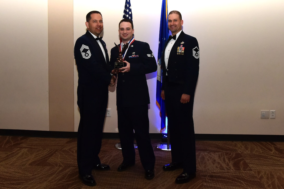 Senior Airman Brandon Moyer accepts the John L. Levitow award during an Airman Leadership School graduation March 23, 2017, at the Leadership Development Center on Buckley Air Force Base, Colo. John L. Levitow is the lowest ranking Airman to earn the Medal of Honor in 1969 during the Vietnam War. (U.S. Air Force photo by Airman 1st Class Jessica Huggins/Released)