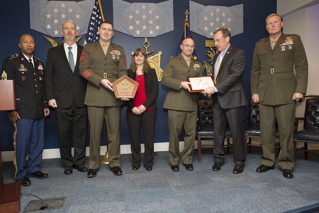Members of the Department of Defense and Marines with the Marine Air Control Group 48, 4th Marine Aircraft Wing, Marine Forces Reserve, pose for a photo at the 2016 Reserve Family Readiness Award ceremony at the Hall of Heroes in the Pentagon, Arlington, Va., March 24, 2017. The Family Readiness Award recognizes the National Guard and Reserve Units with the best programs to support their military families. (U.S. Marine Corps photo by Lance Cpl. Paul A. Ochoa)