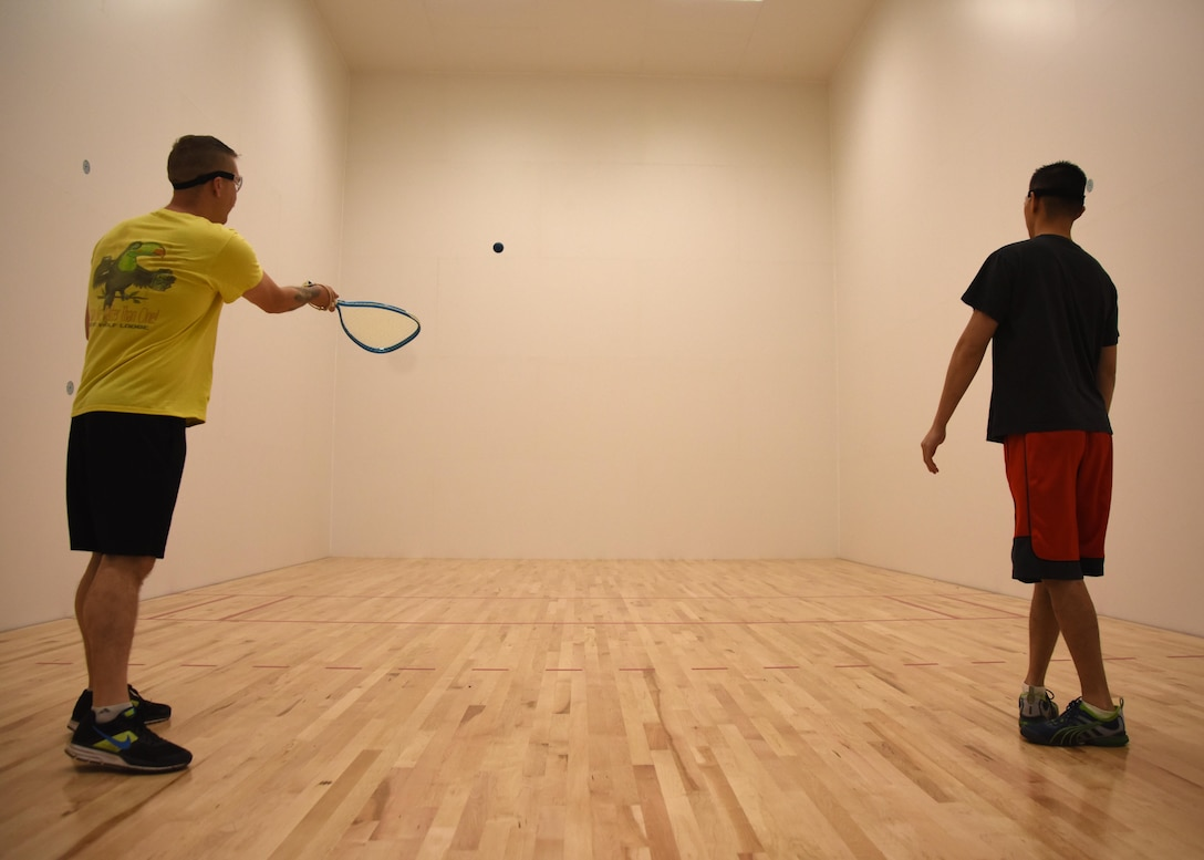Staff Sgt. Kaleb Mayfield, 30th Space Wing Public Affairs broadcaster, plays racquetball with Tech. Sgt. Jim Araos, 30th SW PA NCOIC of command information, March 24, 2017, Vandenberg Air Force Base, Calif. Vandenberg recently reopened its newly renovated racquetball courts, March 24, in Building 9002 behind the 30th FSS Fitness and Sports Center Annex. (U.S. Air Force photo by Airman 1st Class Clayton Wear/Released)