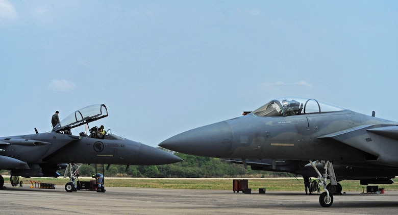 A U.S. Air Force F-15 (front) taxis past a Republic of Singapore air force F-15 during exercise Cope Tiger 17 at Korat Royal Thai Air Force Base, Thailand, March 24, 2017. The annual multilateral exercise, which involves a combined total of 76 aircraft and 43 air defense assets, is aimed at improving combined combat readiness and interoperability between the Republic of Singapore air force, Royal Thai air force, and U.S. Air Force, while concurrently enhancing the three nations' military relations. (U.S. Air Force photo by Staff Sgt. Kamaile Chan)