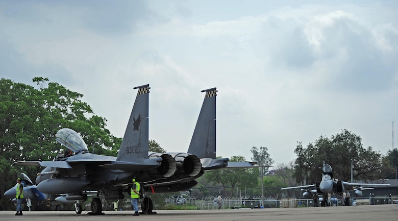 A Republic of Singapore air force F-15 (front) sits across from a U.S. Air Force F-15 after completing a training mission during exercise Cope Tiger 17 at Korat Royal Thai Air Force Base, Thailand, March 24, 2017. The annual multilateral exercise, which involves a combined total of 76 aircraft and 43 air defense assets, is aimed at improving combined combat readiness and interoperability between the Republic of Singapore air force, Royal Thai air force, and U.S. Air Force, while concurrently enhancing the three nations' military relations. (U.S. Air Force photo by Staff Sgt. Kamaile Chan)