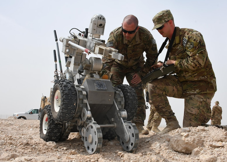 U.S. Air Force Tech. Sgt. Jeremy Pifer, left, and Staff Sgt. Brent Points, both explosive ordnance disposal technicians with the 379th Expeditionary Civil Engineer Squadron Explosive Ordnance Disposal flight, move an F6A bomb disposal robot at Al Udeid Air Base, Qatar, March 17, 2017. Both Brent and Pifer deployed from Dobbins Air Reserve Base, along with two other EOD technicians. (U.S. Air Force photo by Senior Airman Miles Wilson)