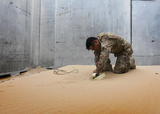 U.S. Air Force Staff Sgt. Juan Ortiz, an explosive ordnance disposal technician with the 379th Expeditionary Civil Engineer Squadron Explosive Ordnance Disposal Flight, places a C4 charge inside of the new EOD range at Al Udeid Air Base, Qatar, March 17, 2017. The new EOD range at Al Udeid allows for the EOD technicians to train with live explosives, as well as acts as an location for emergency detonations of munitions. (U.S. Air Force photo by Senior Airman Miles Wilson)