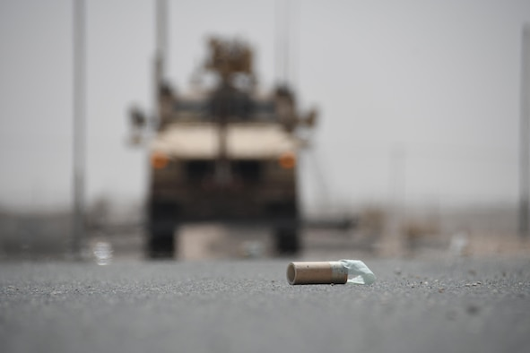 An improvised explosive device prop lies on a simulated airfield at Al Udeid Air Base, Qatar, March  21, 2017. The 379th Expeditionary Civil Engineer Squadron Explosive Ordnance Disposal Flight conducted an exercise that involved sweeping IED's off of a simulated runway with a mine resistant ambush protected all-terrain vehicle, and then disposing of them safely. (U.S. Air Force photo by Senior Airman Miles Wilson)