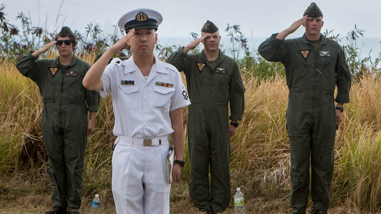 U.S. and Japanese service members salute the nations' flags during the presentation of the colors on March 25, 2017 during the 72nd Reunion of Honor ceremony on Iwo To, Japan. The event presented the opportunity for the U.S. and Japanese people to mutually remember and honor thousands of service members who fought and died on the hallowed grounds of Iwo Jima.