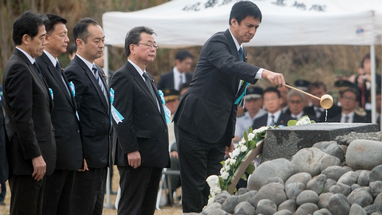 Shunsuke Takei, Japanese parliamentary vice-minister for foreign affairs, dedicates water on an Iwo Jima memorial during a wreath-laying presentation as part of the 72nd Reunion of Honor ceremony on Iwo To, Japan March 25, 2017. The event presented the opportunity for the U.S. and Japanese people to mutually remember and honor thousands of service members who fought and died on the hallowed grounds of Iwo Jima.