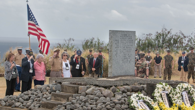 World War II veterans salute a memorial after placing a wreath at the base during a wreath-laying presentation as part of the 72nd Reunion of Honor ceremony on Iwo To, Japan March 25, 2017. The event presented the opportunity for the U.S. and Japanese people to mutually remember and honor thousands of service members who fought and died on the hallowed grounds of Iwo Jima.
